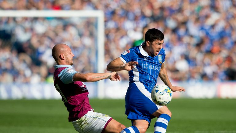 SHEFFIELD, ENGLAND - AUGUST 07: Alan Hutton of Aston Villa is challenged by Fernando Forestieri of Sheffield Wednesday during the Sky Bet Championship matc