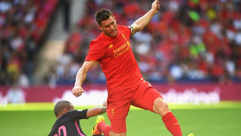 James Milner of Liverpool is tackled by Barcelona's Aleix Vidal