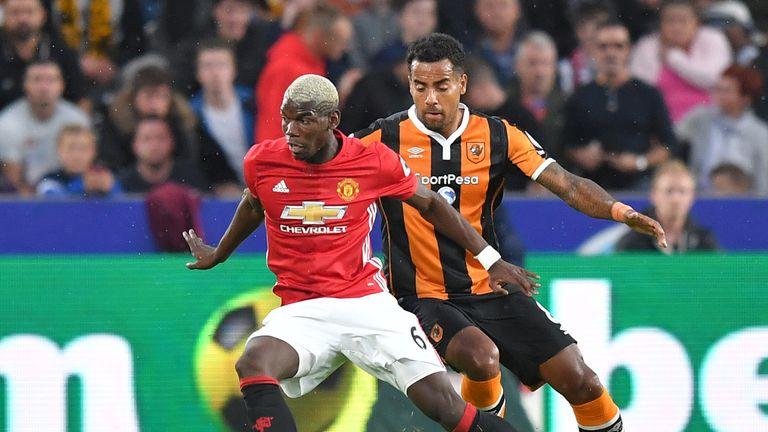 Manchester United's Paul Pogba battles with Hull City's Tom Huddlestone