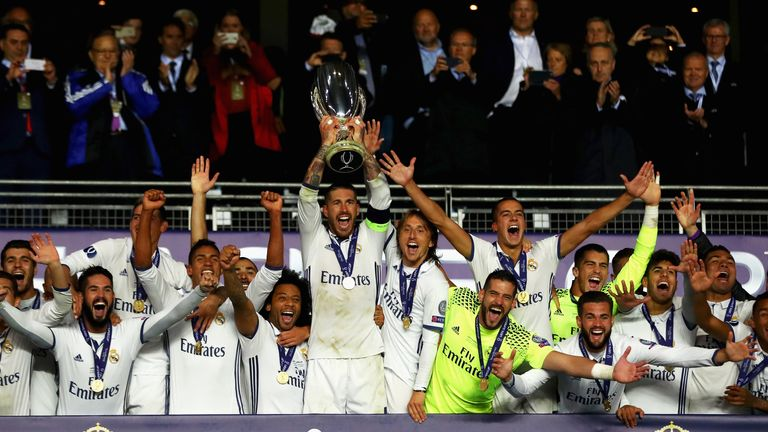 Sergio Ramos of Real Madrid lifts the trophy after his team's victory during the UEFA Super Cup