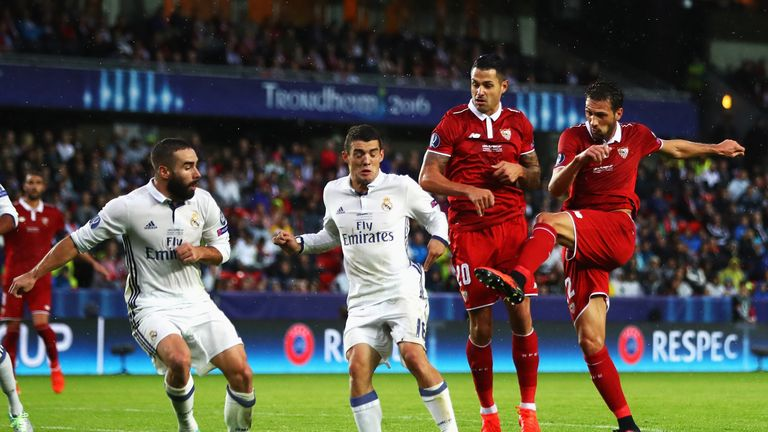 Franco Vazquez (R) of Sevilla scores his team's opening goal during the UEFA Super Cup match between Real Madrid and Sevilla