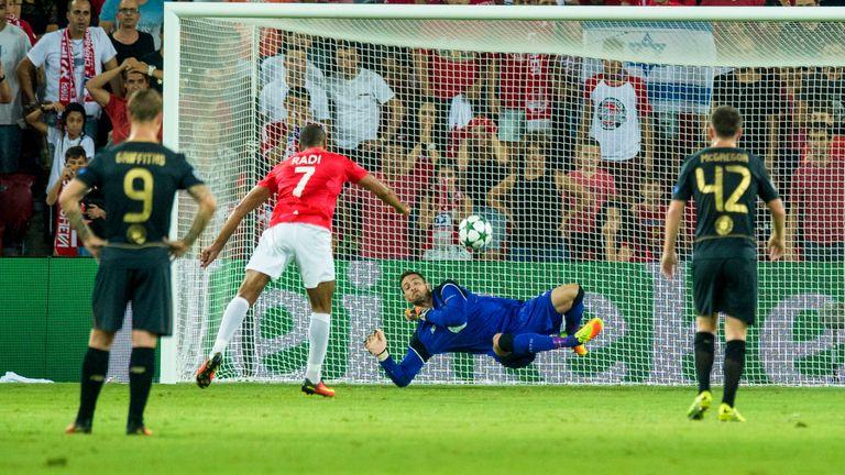 Celtic goalkeeper Craig Gordon saves Hapoel's Maharan Radi's penalty