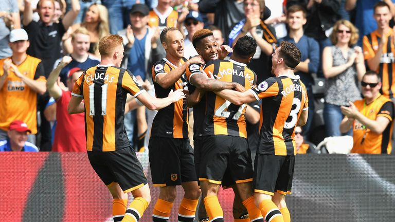 HULL, ENGLAND - AUGUST 13: Abel Hernandez of Hull City celebrates scoring his sides first goal with his team mates during the Premier League match between