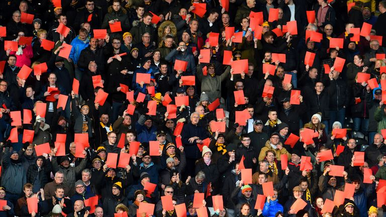 Hull City's fans protested by showing red cards during their clash with Brentford in April