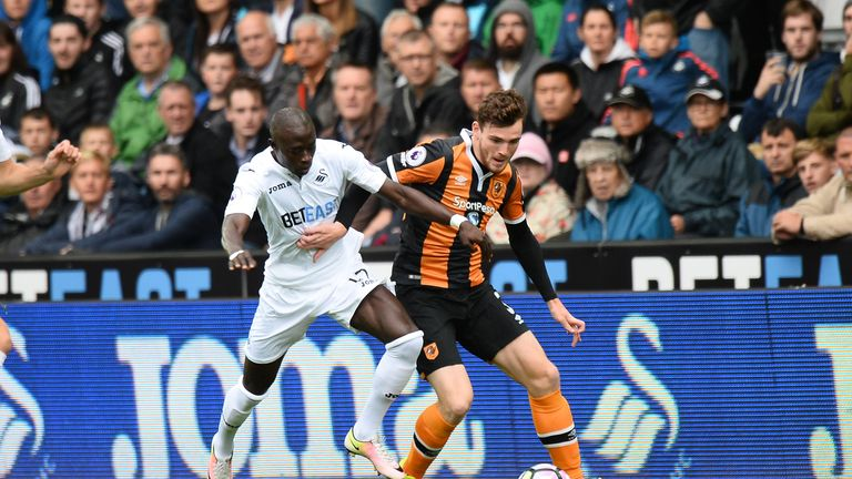Madou Barrow of Swansea City battles for the ball with Andrew Robertson of Hull
