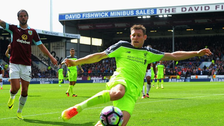 BURNLEY, ENGLAND - AUGUST 20: James Milner of Liverpool attempts to keep the ball in play during the Premier League match between Burnley and Liverpool at