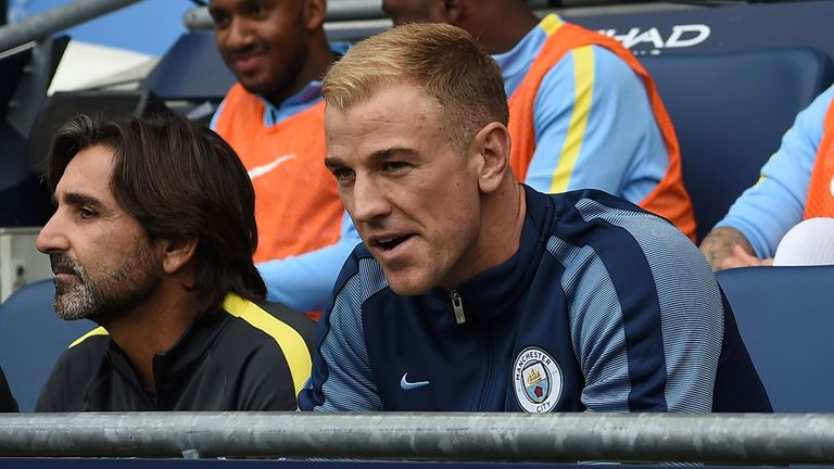 Joe Hart sits on the bench after being dropped for Manchester City's opening game of the season.