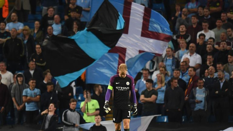Manchester City's English goalkeeper Joe Hart walks on the field at the end of the UEFA Champions League second leg play-off football match between Manches
