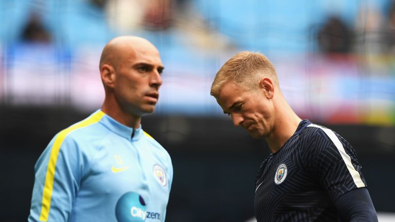 MANCHESTER, ENGLAND - AUGUST 13: Willy Cabellero of Manchester City (L) and Joe Hart of Manchester City (R) warm up prior to kick off during the Premier Le