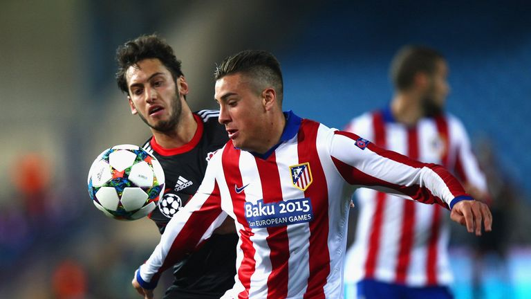 Jose Gimenez (R) of Atletico Madrid and Calhanoglu (L) battle for the ball in Champions League action