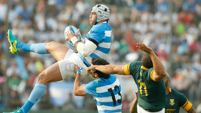 Leguizamon of Argentina fights for the ball with Habana