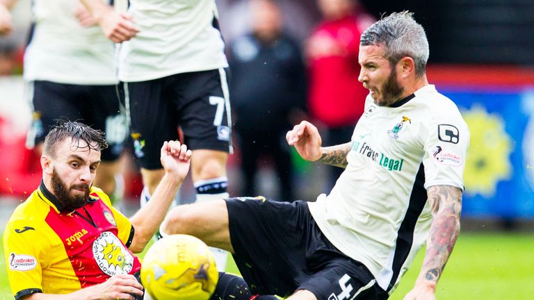 Kevin McNaughton wins a challenge against Partick Thistle's Steven Lawless