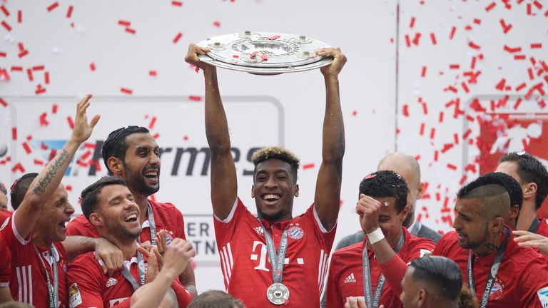 MUNICH, GERMANY - MAY 14: Kingsley Coman of Muenchen lifts the Meisterschale as players and staffs celebrate the Bundesliga championship after the Bundesli