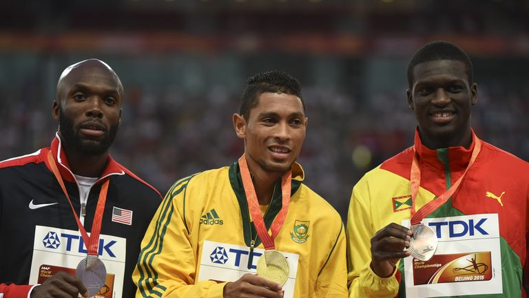 Van Niekerk (centre) is flanked by USA's bronze medallist LaShawn Merritt (left) and Grenada's silver medallist Kirani James