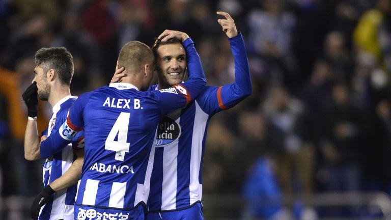 Lucas Perez (R) hugs his Deportivo team-mate Alex Bergantinos after scoring their second goal