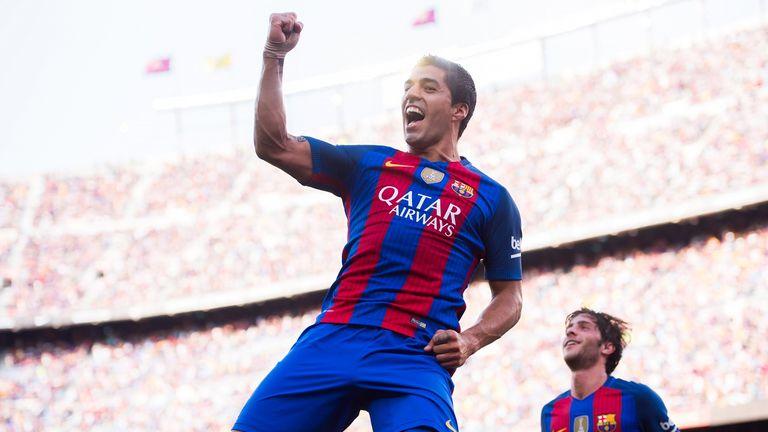Luis Suarez celebrates after scoring Barcleona's third goal