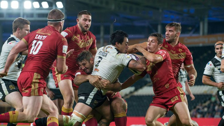 Man of the match Mahe Fonua charges through the Catalan Dragons' tackles