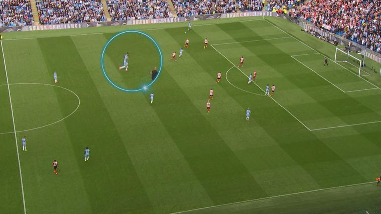 After passing the ball out to the left flank, Gael Clichy turns his head infield to check on City's defensive positioning
