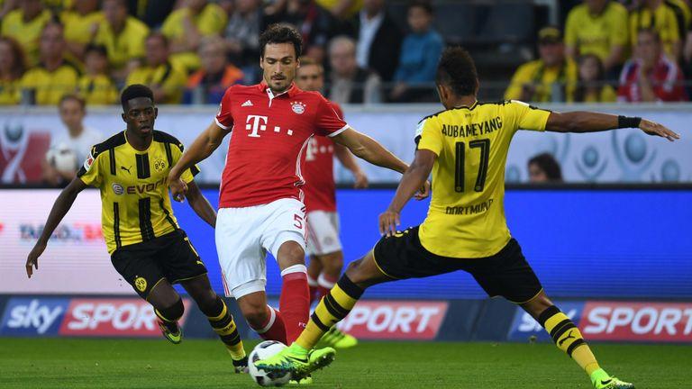 Bayern Munich's defender Mats Hummels (C) fights for the ball with Dortmund's Gabonese striker Pierre-Emerick Aubameyang during the German Super Cup footba