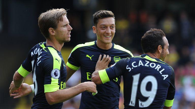 Mesut Ozil celebrates his goal in Arsenal's Premier League win at Watford with Nacho Monreal and Santi Cazorla