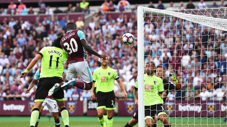 LONDON, ENGLAND - AUGUST 21: Michail Antonio of West Ham United heads the opening goal during the Premier League match between West Ham United and AFC Bour