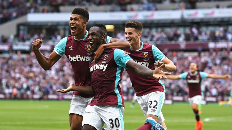 LONDON, ENGLAND - AUGUST 21: Michail Antonio (#30) of West Ham United celebrates scoring the opening goal with team mates during the Premier League match b
