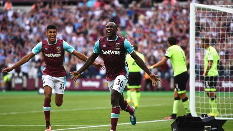 LONDON, ENGLAND - AUGUST 21:  Michail Antonio (#30) of West Ham United celebrates scoring the opening goal with team mate Ashley Fletcher during the Premie