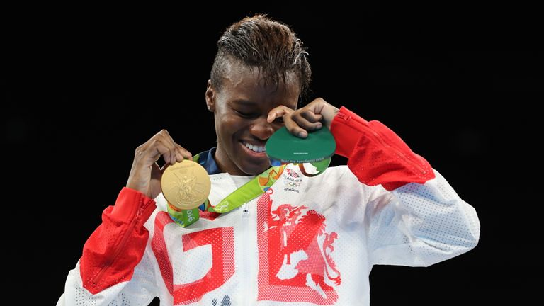 Adams sheds a tear on the podium after receiving her gold medal