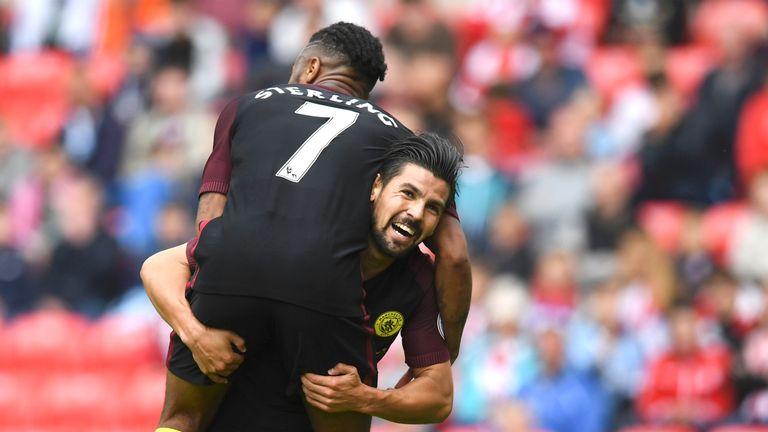 Nolito (R) celebrates his goal with team-mate, Raheem Sterling