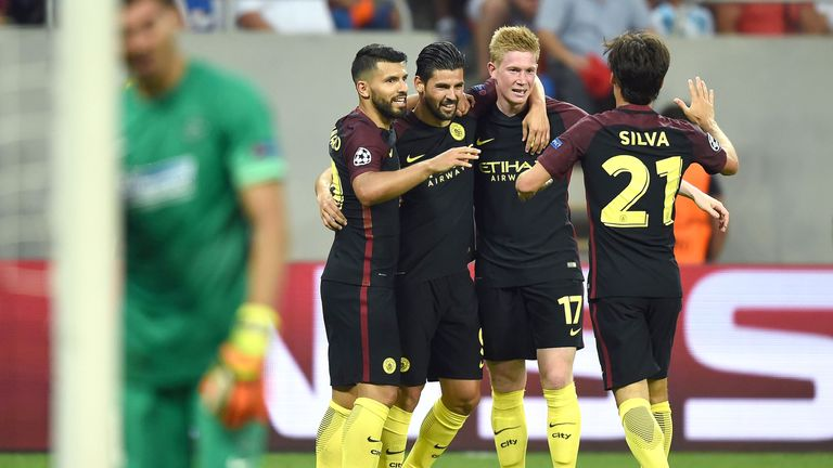 Nolito (2L) celebrates with teammates after scoring Manchester City's third