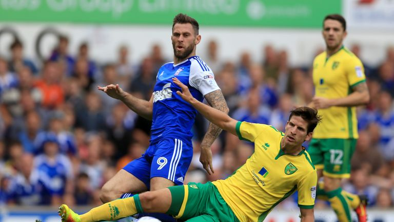 Murphy in action for Ipswich against Norwich earlier this season