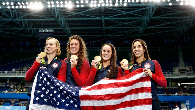 Allison Schmitt, Leah Smith, Maya Dirado and Katie Ledecky of the United States won gold in the 4x200m freestyle relay
