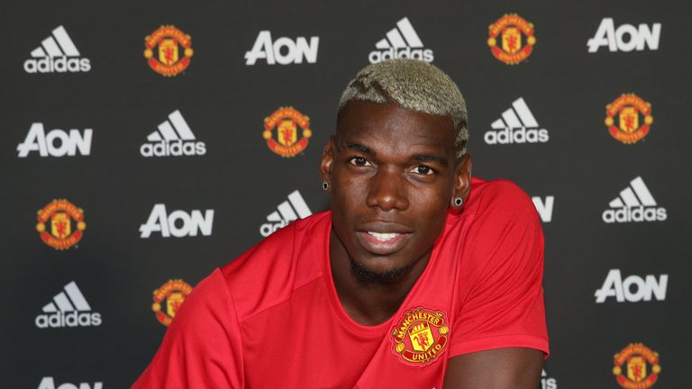 MANCHESTER, ENGLAND - AUGUST 08:  (EXCLUSIVE COVERAGE) Paul Pogba of Manchester United poses after signing for the club at Aon Training Complex on August 8