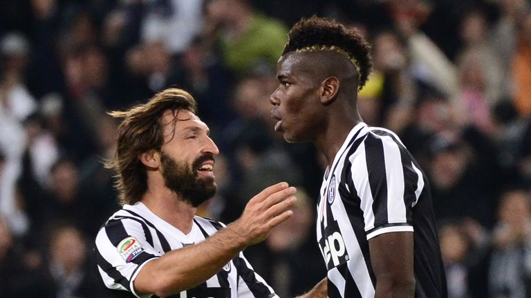 Juventus' French midfielder Paul Labile Pogba (R) celebrates after scoring a goal, with Juventus' midfielder Andrea Pirlo