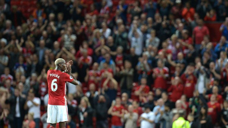 Paul Pogba applauds the fans at Old Trafford