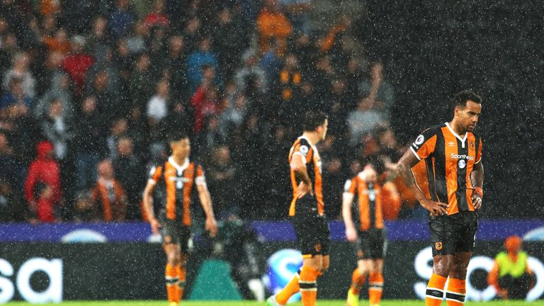 Tom Huddlestone and his Hull City team-mates appear dejected after Marcus Rashford's goal