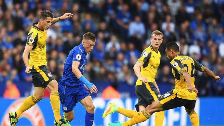 Francis Coquelin attempts to control the ball while under pressure from Jamie Vardy