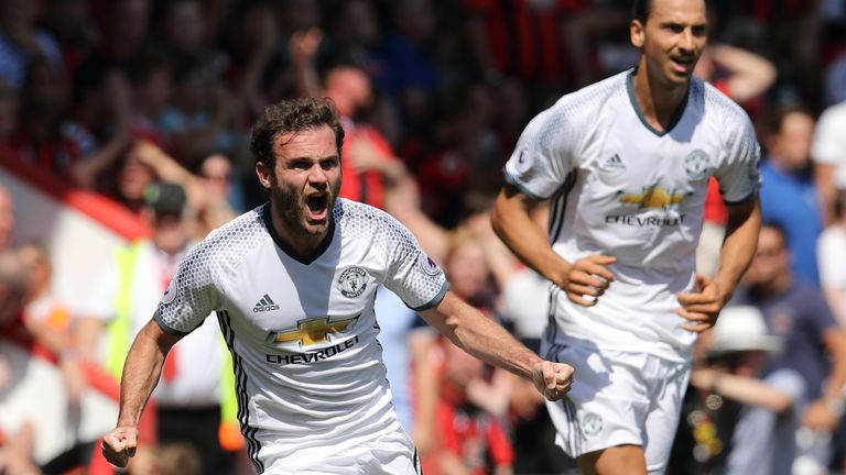 Juan Mata celebrates after scoring the opening goal for Manchester Untied