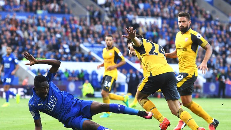 Ahmed Musa (L) goes to ground under pressure from Hector Bellerin
