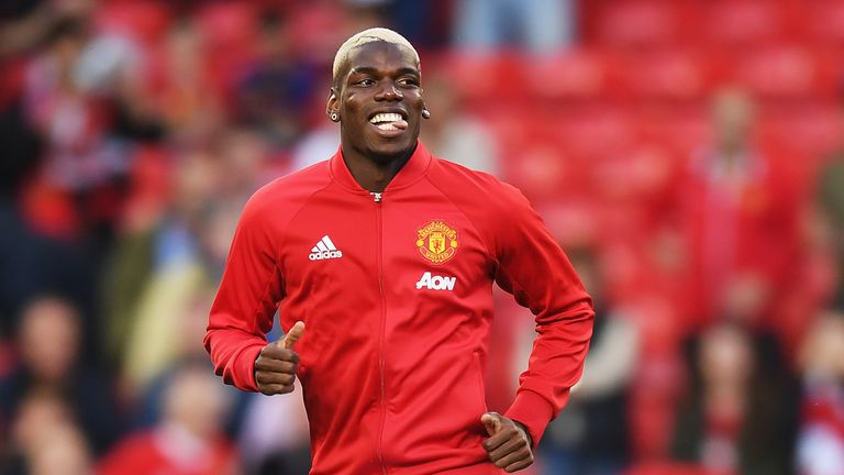 Paul Pogba warms up prior to kick-off at Old Trafford
