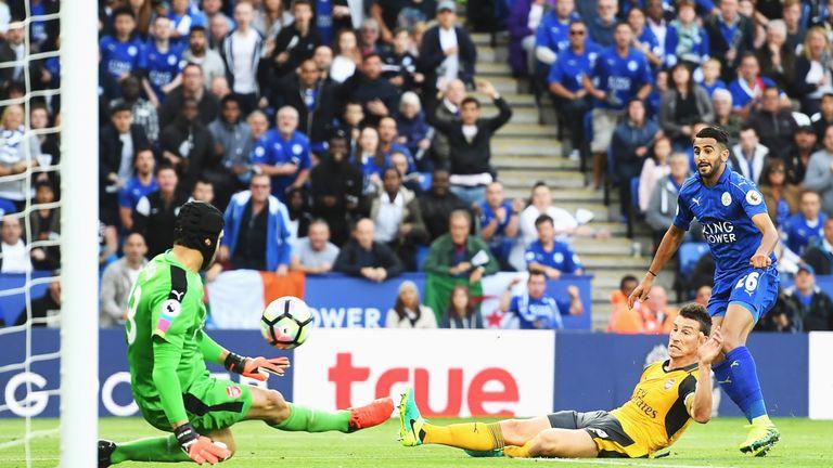 Petr Cech (L) saves a shot on goal from Riyad Mahrez