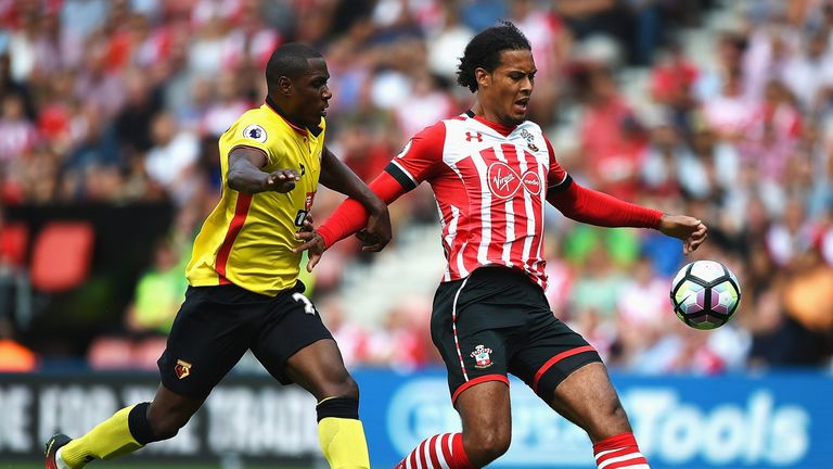 Virgil van Dijk battles Odion Ighalo in the first half