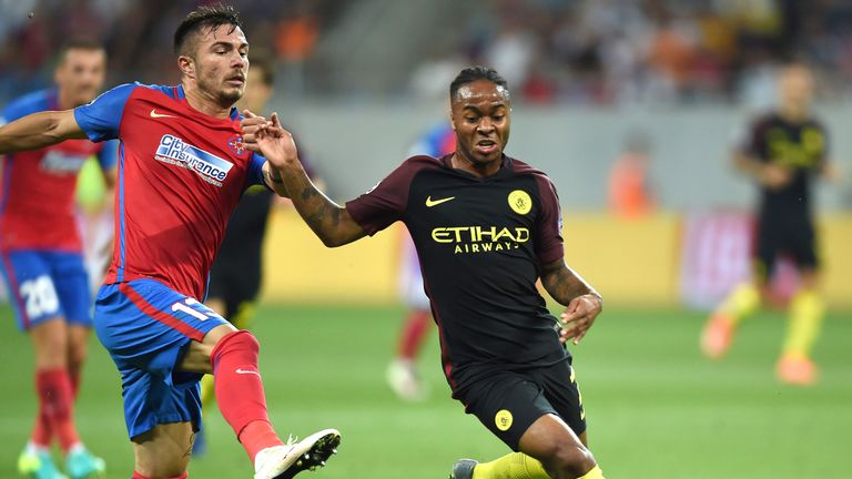 Raheem Sterling (R) vies for the ball with defender Alin Tosca