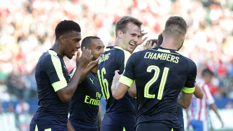 CARSON, CA - JULY 31:  (L-R) Alex Iwobi #17, Theo Walcott #14, Rob Holding #16 and Calum Chambers #21 of Arsenal celebrate Holding's first half goal agains