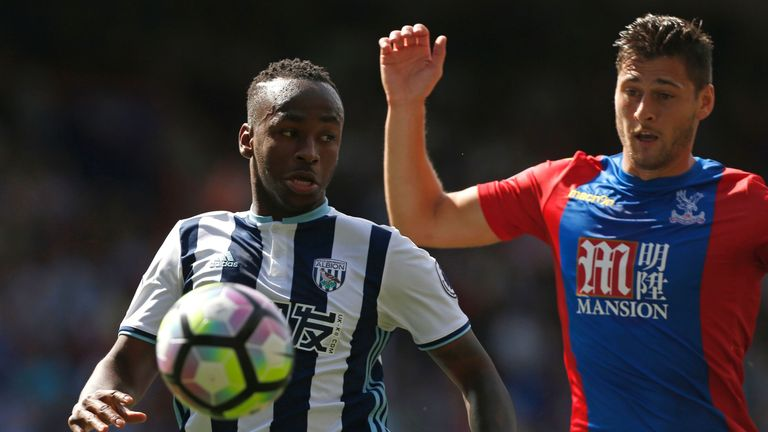 Saido Berahino (L) vies with Palace defender Joel Ward