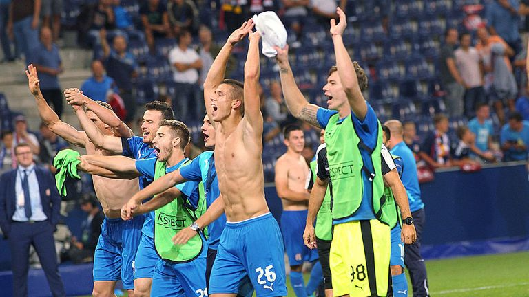 Zagreb's players celebrate during the UEFA Champions League Qualification Play-offs match Red Bull Salzburg vs Dinamo Zagreb