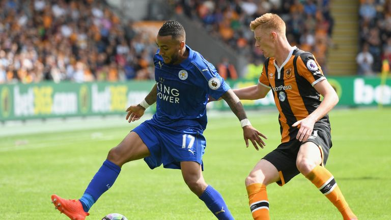 HULL, ENGLAND - AUGUST 13: Danny Simpson of Leicester City shields the ball from Sam Clucas of Hull City during the Premier League match between Hull City