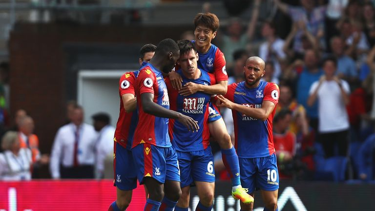 Scott Dann (C) is mobbed after his equaliser earned a point