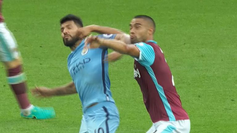 Sergio Aguero clashes with Winston Reid during Manchester City's 3-1 victory over West Ham