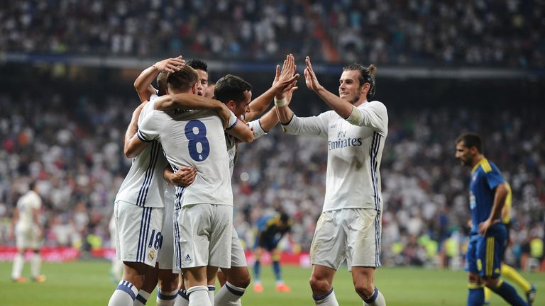 Kroos is mobbed by Real Madrid celebrates with team-mates